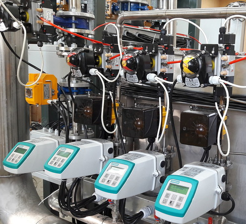 Reference master flowmeters Siemens, Woltman calibration, hot water meter calibration test bench,  flow meter calibration system, standard fluid flow measurement, flow metering, ISO 4064, ISO 4185, OIML R105, OIML R49, EN 14154, volume flow, mass flow, liquid flow, fluid flow, water meter verification, calibration verification testing  flowmeter, thermal mass volumetric flowmeter calibration, calibration Promass, Micro Motion, CMFHC, Optimass, Rotamass, flow measuring systems, Metrology Systems Engineering Company, calibration Krohne, calibration Endress+Hauser, calibration Emerson, calibration Siemens, calibration Yokogawa,  معايرة عداد التدفق ، معايرة عداد المياه ، اختبار مقياس الجريان ،نظام معايرة متر التدفق